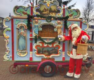 Kerstman met draaiorgel kerstmuziek kerst santa claus huren